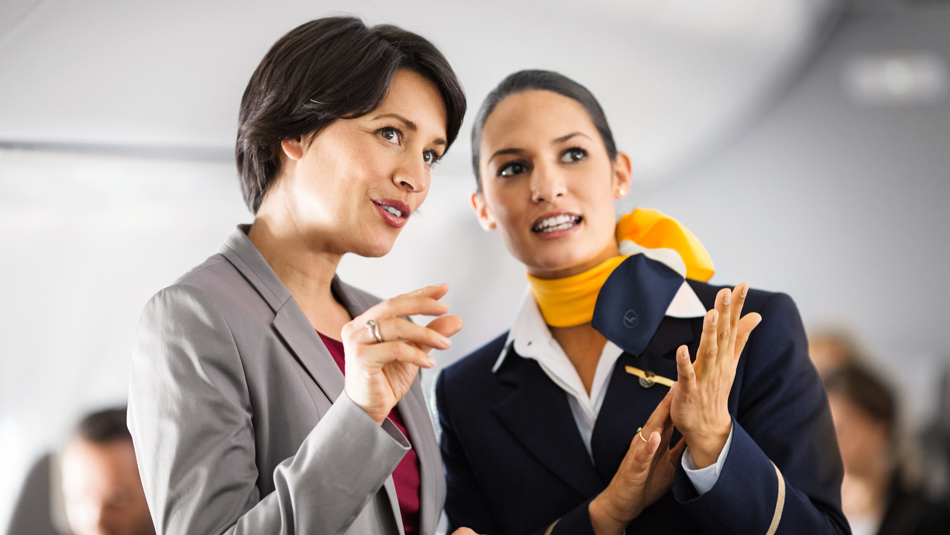 A Lufthansa employee talking to a customer