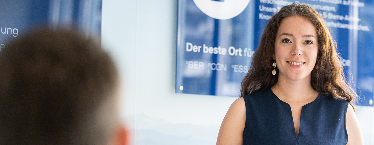 A smiling woman at Lufthansa Aviation Training Headquarters